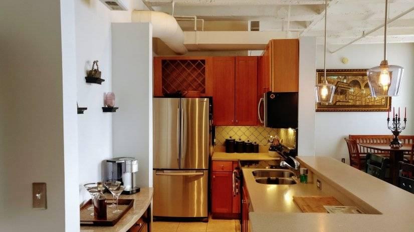 Kitchen with dishwasher, ceramic range, microwave, kcup brew