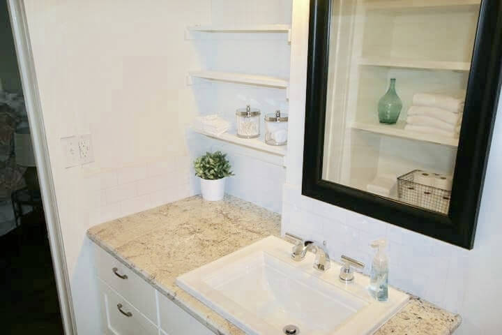 Lots of storage and shelves with granite and