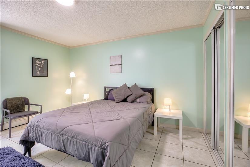 Main bedroom contains one Queen bed (sleeps 2