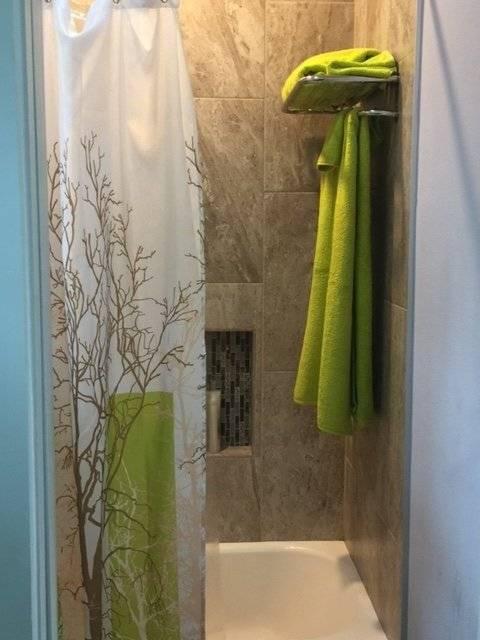 Spa bath, tub with tile surround, Designer fixtures