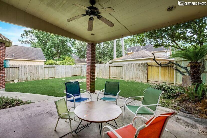 Backyard patio with fan and outdoor lights of