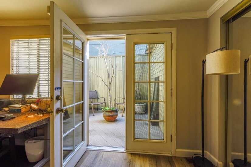 French doors onto side patio from 2nd bedroom/office