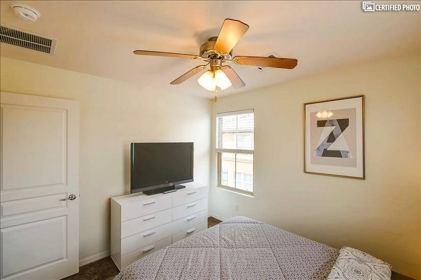 Bed Room 2 with smart television & furniture