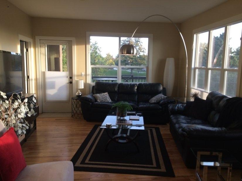 Brightly lite Living Room hardwood floors