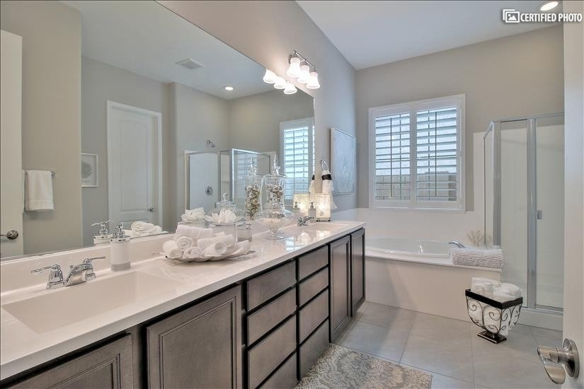 Master bath with tub and shower. Many elegant appointments.