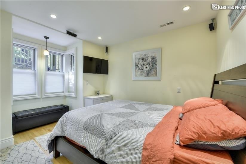Bright front queen bedroom