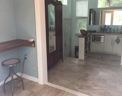 PC desk, antique wardrobe, kitchen area, entrance