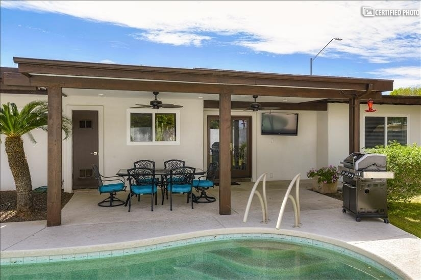 Large covered patio with Seating & TV
