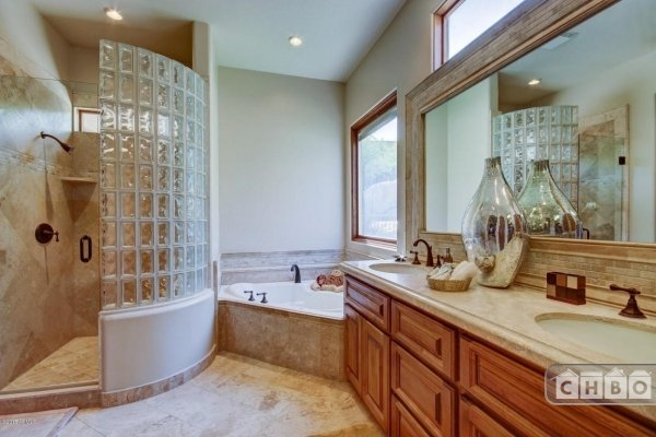 Guest bedroom bath with walk-in shower and separate bath tub