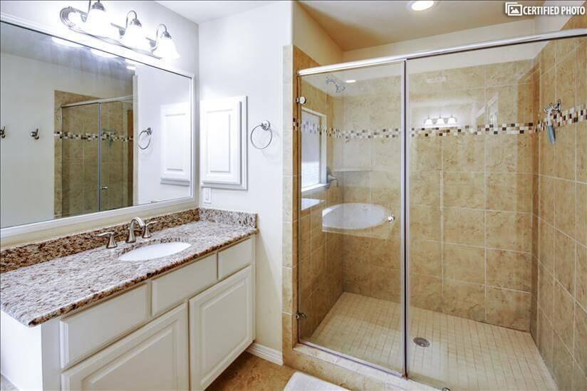 Large shower & 1 of 2 granite vanities