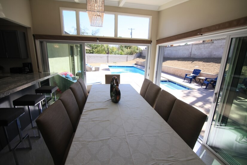 main house dining table and pool