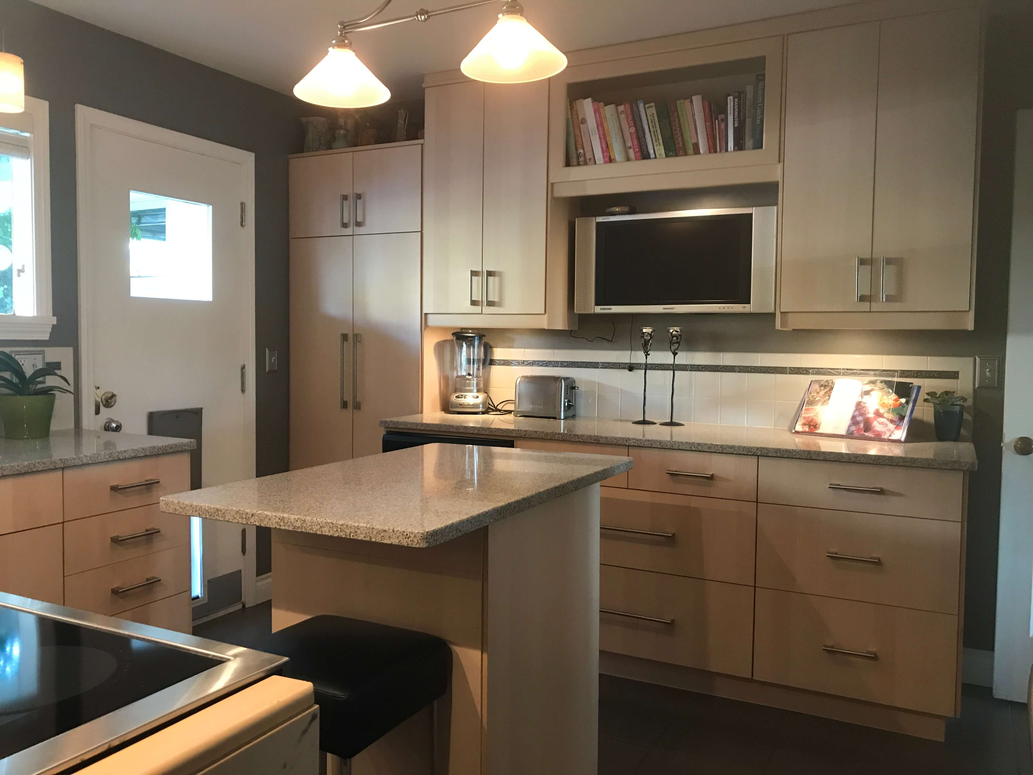 Comfortable highly functional kitchen has access to garden