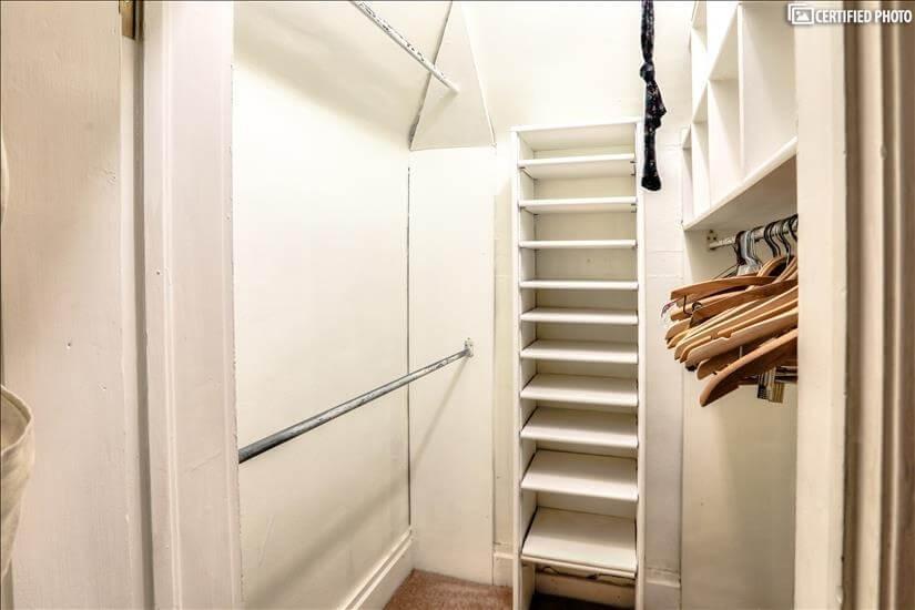Additional walk-in closet in hallway.
