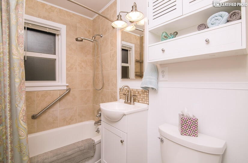 Sparkling Clean Bathroom with Tub/Shower Combo, Med Cabinet