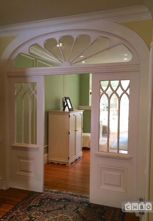 Original arches leading to dining room.