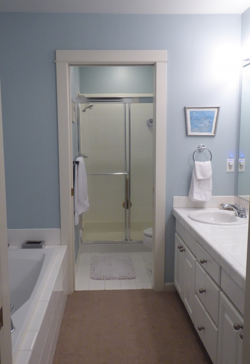 The master bath features two sinks, a soaking