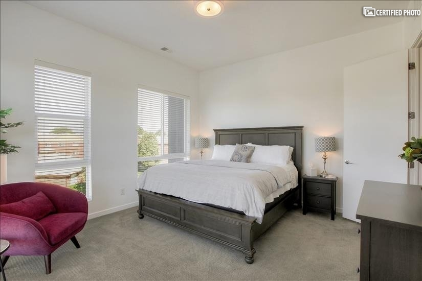 Master bedroom has a king-size bed