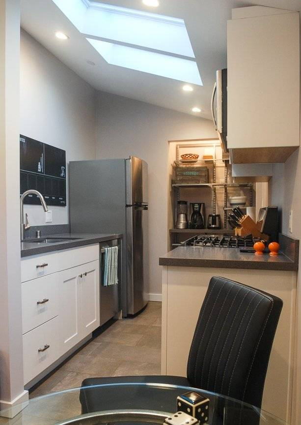 Natural light flows into kitchen through skylights