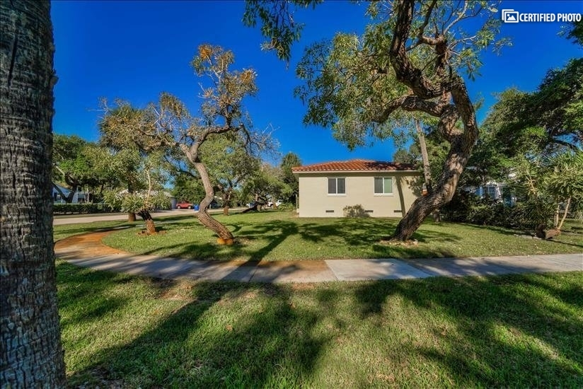 Large corner lot with plenty of space around home.