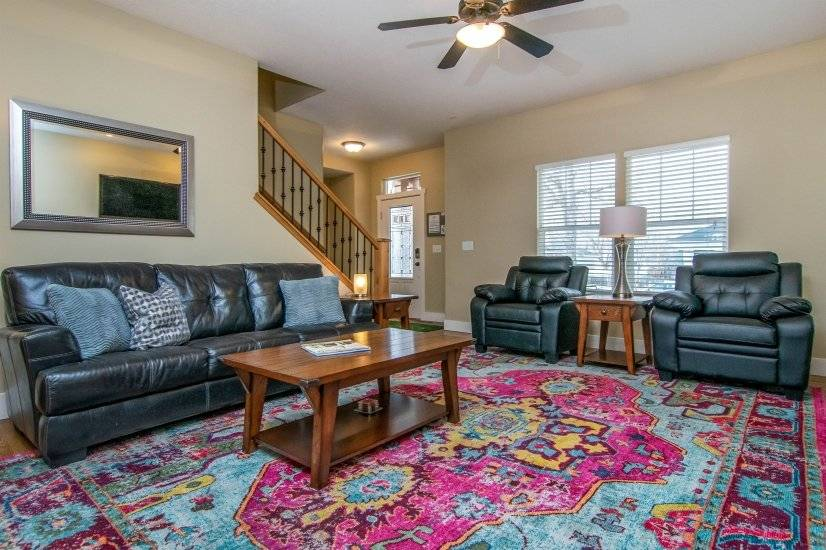 Family Room with comfortable leather sofa and chairs