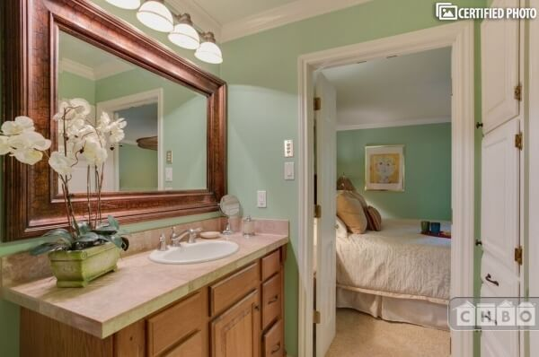 Master bath with double doors opening into Ma