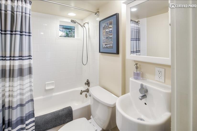 Full bathroom with tub & shower.