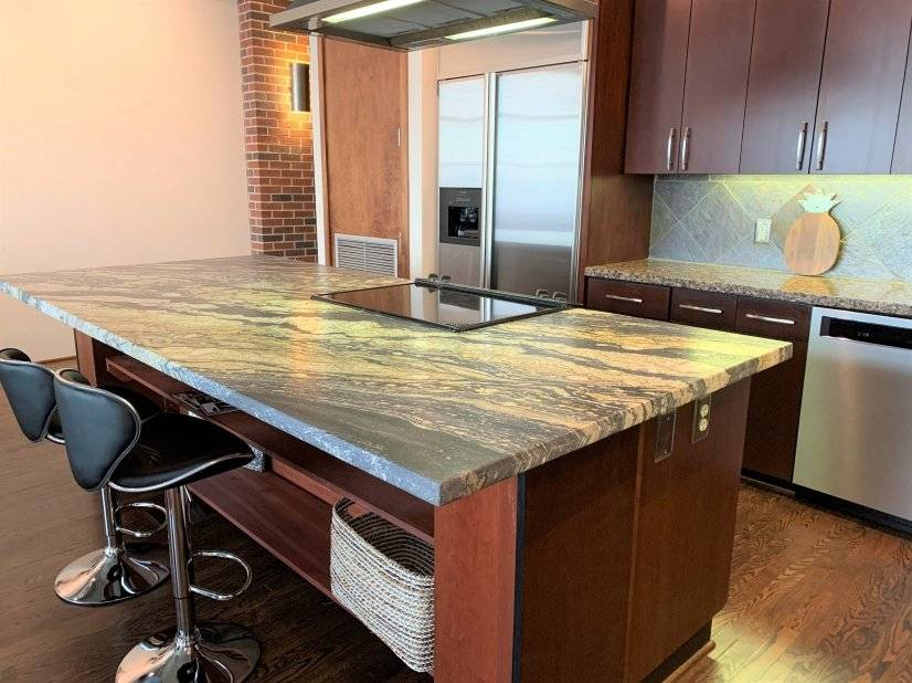 All stainless steel KitchenAid appliances, granite counters.