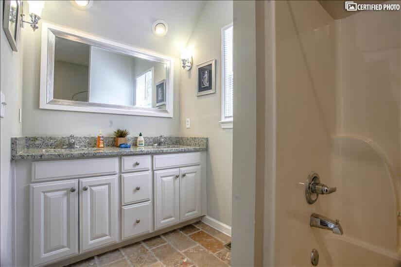 Double vanity sink in Master over Garage.