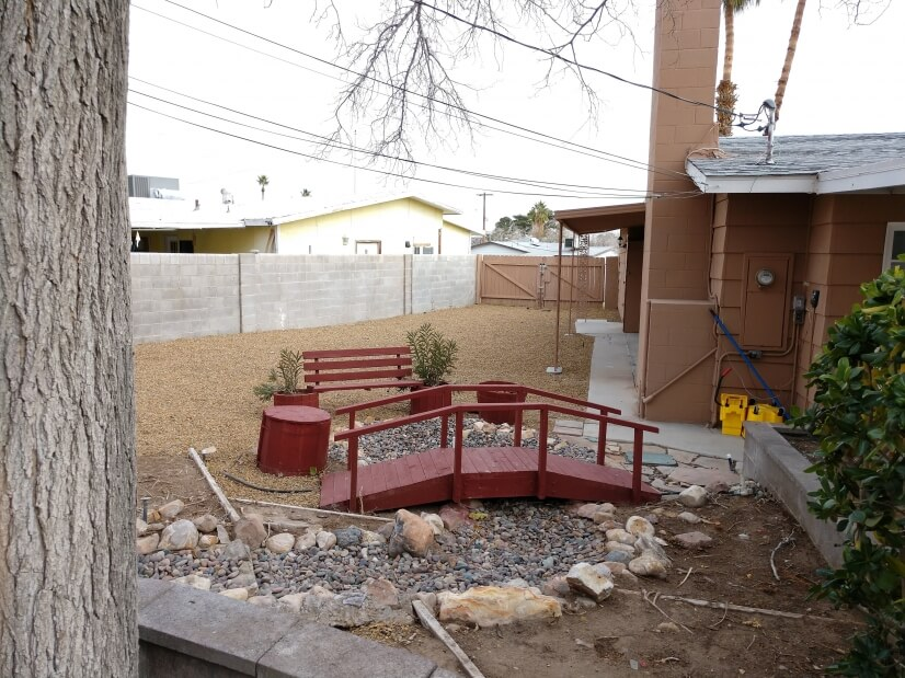 Side yard with bridge, seating & RV parking