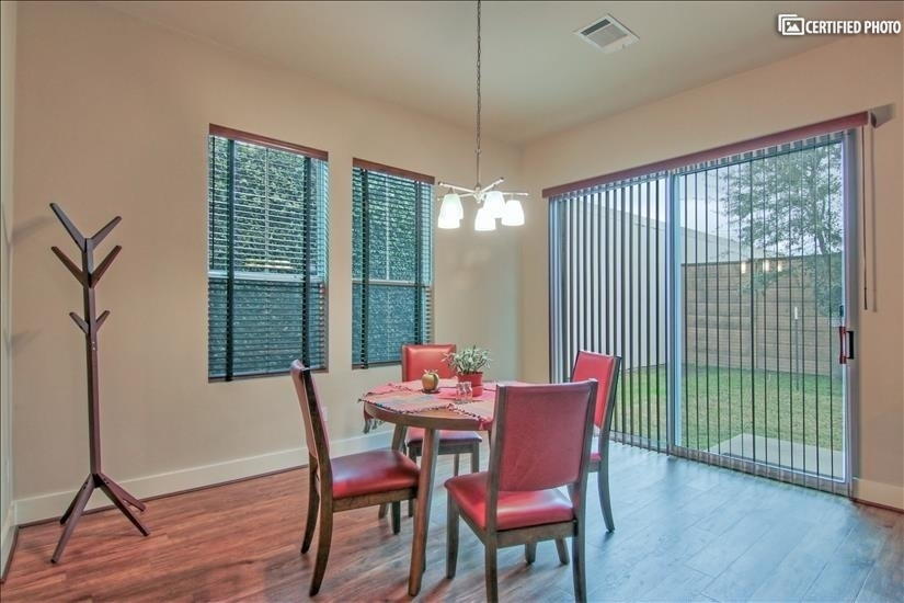 Beautiful dining area with a great view of the backyard!