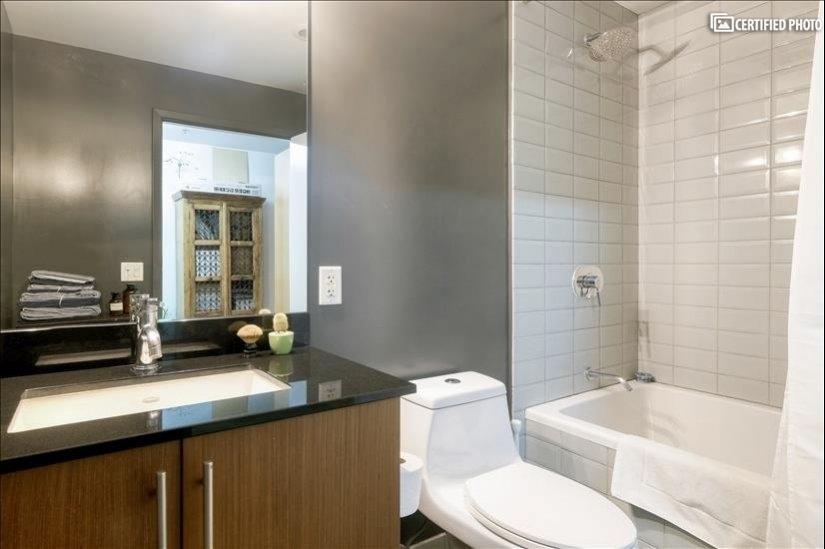 Full bath with granite countertops