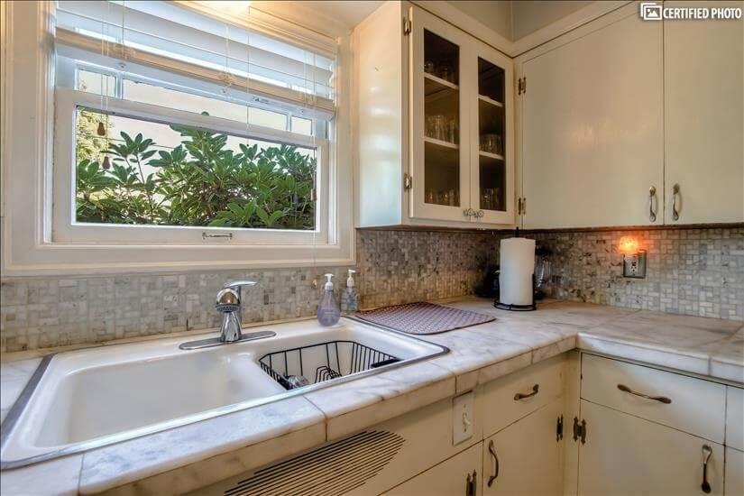 Kitchen window faces original Queen Anne's Vi