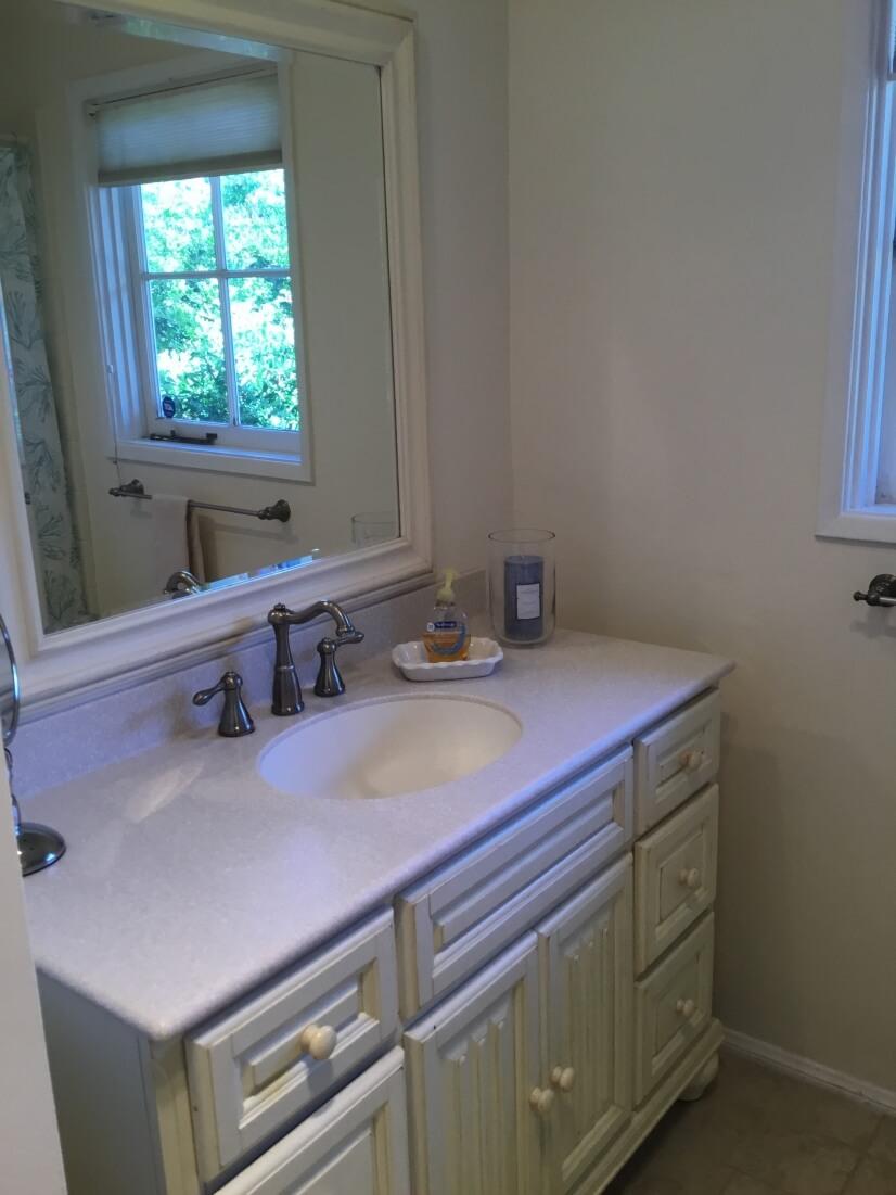 Full bathroom has a full tub/shower
