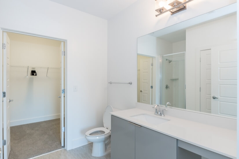 Bathroom and adjacent closet