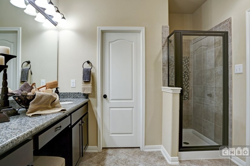 Granite counters and separate shower in master.