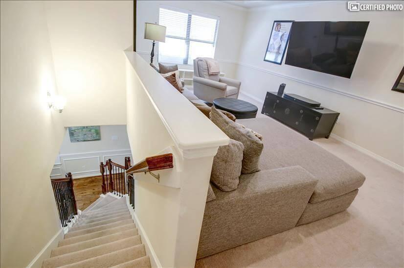 Stairway access to media room & bedrooms