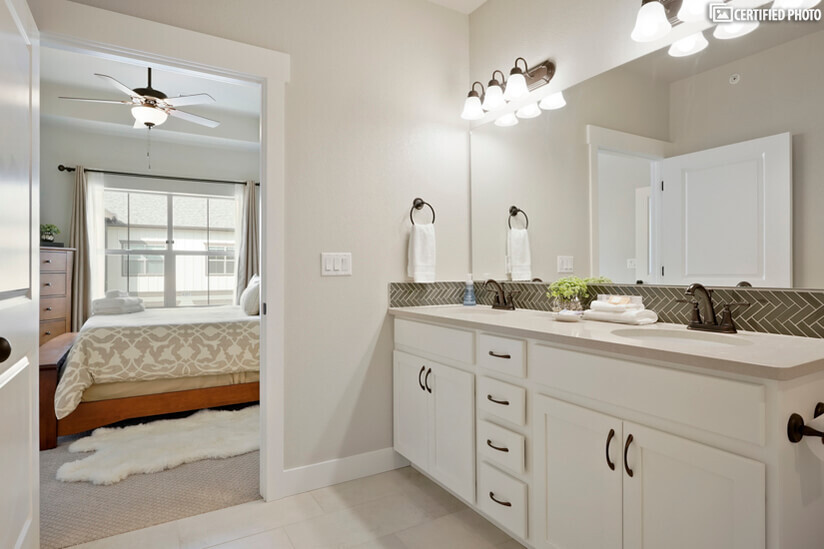 High end quartz and modern tiled floor and backsplash