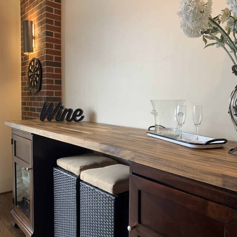 Wine bar with seating, wine racks and plenty of stemware.