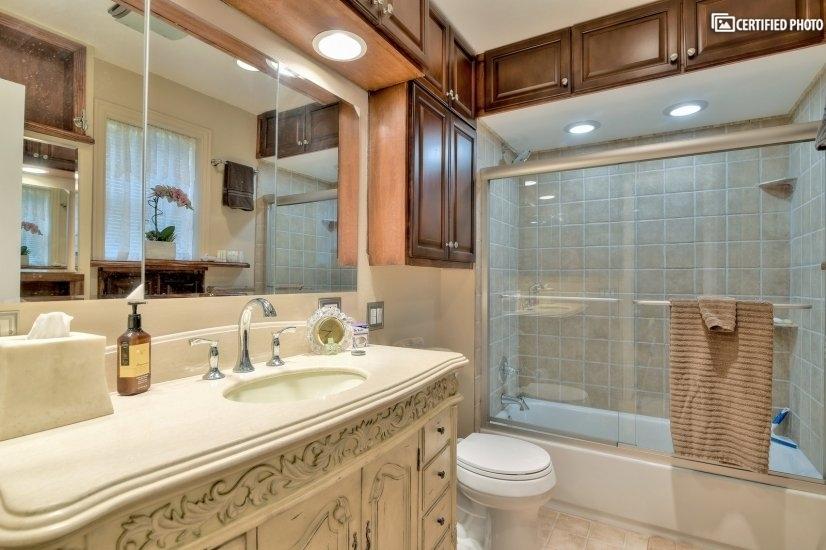 Marble vanity near shower/tub area.