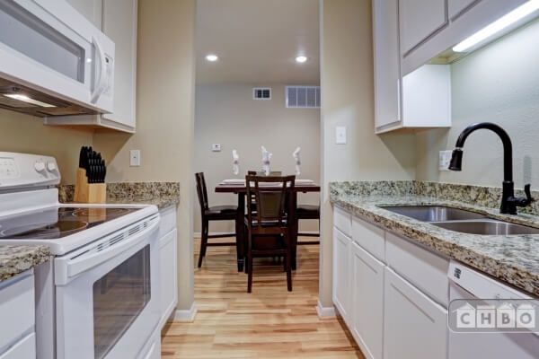 granite counters, appliances less than 2 years old.