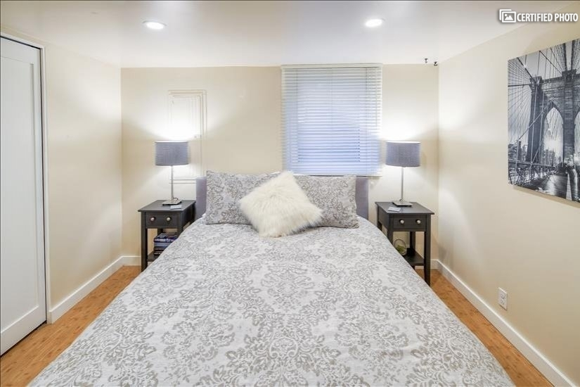 Queen sized bed, end tables & egress window 2