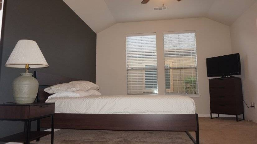 Master Bedroom with King Bed, TV, Night stand, and dresser