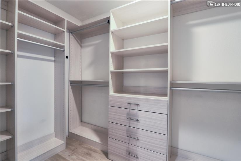 Bedroom custom closets include  drawers and shelves