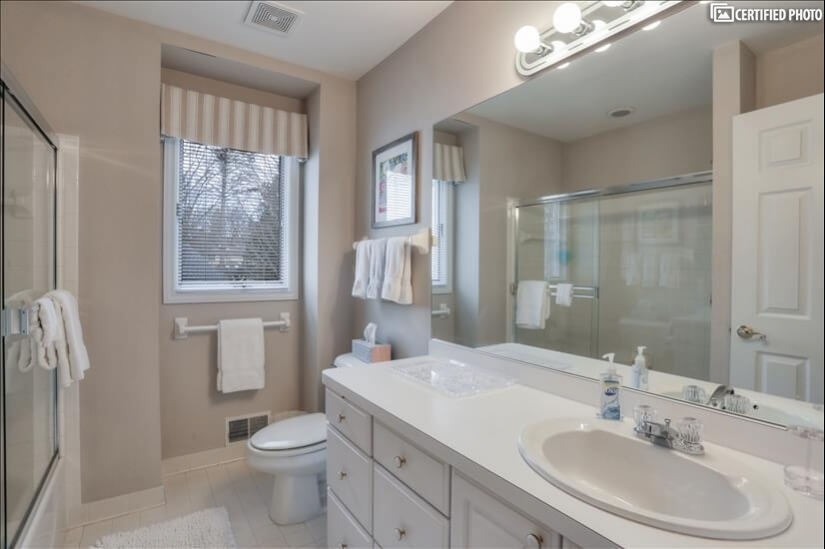 Second-floor bathroom with single sink and tub shower.