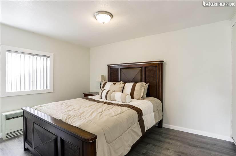 Bedroom with Queen Serta Mattress