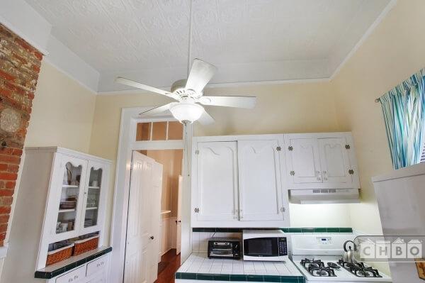 Original pressed tin ceiling and transom windows.