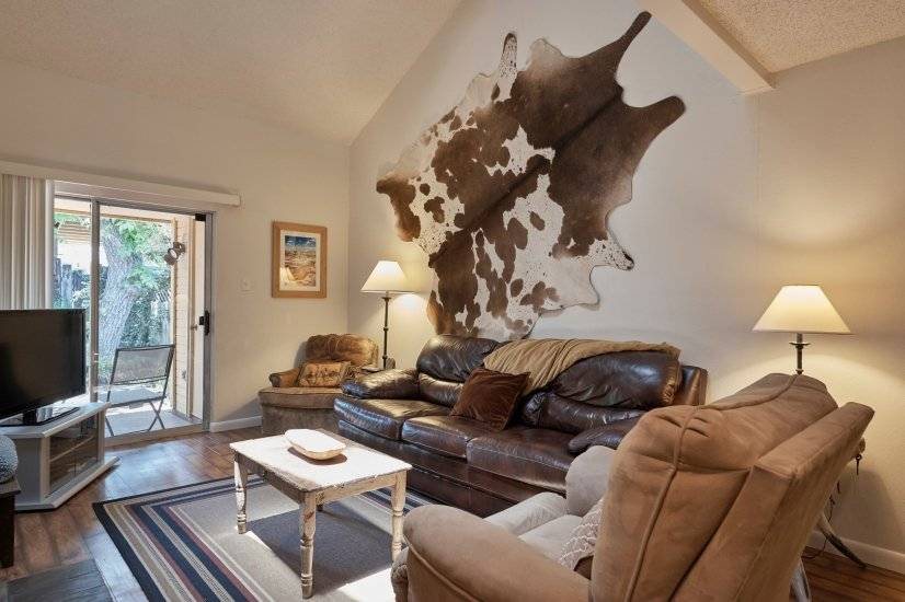 Living room-large flat screen tv and Texas style cowhide!