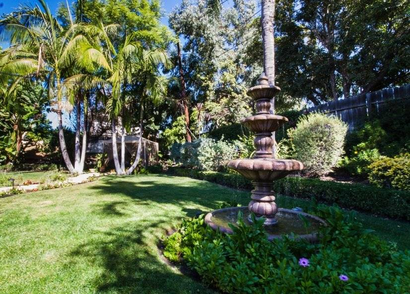 Private fenced backyard, lawn, cabana, mature trees & palms