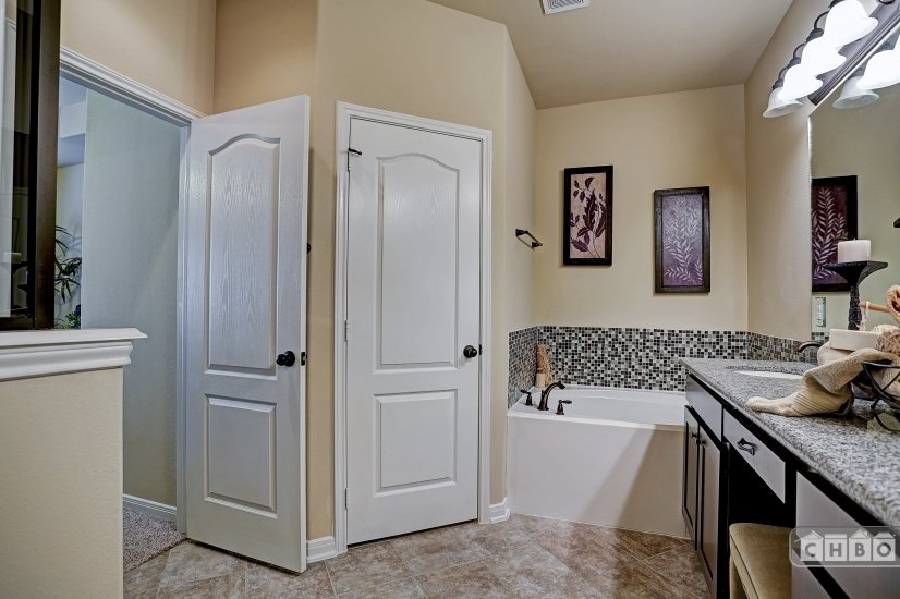Double sinks in master with separate tub and shower