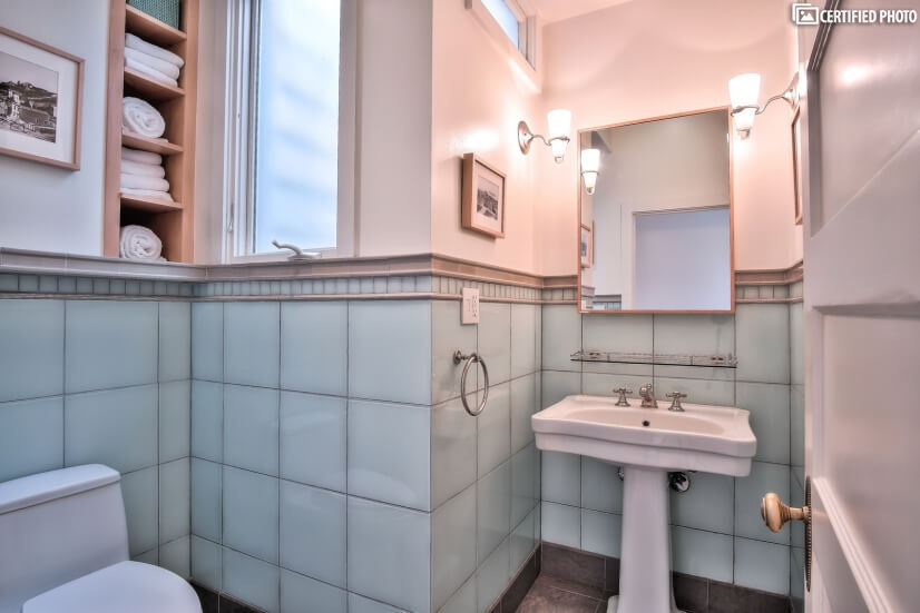 Hall bath with glass tiles and heated floor